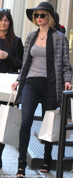 Jennifer Lawrence dressed to impress in open-toed stiletto boots, not exactly the most comfortable choice of footwear for a shopping spree
