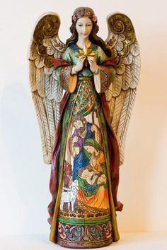 This is truly a Christmas angel, with the Nativity on her dress. By Roman and purchased in St. Patricks Cathedral in NYC--photo by Mike Oberg Christmas Nativity, Christmas Angels, Jim Shore Christmas, I Believe In Angels, Ange Demon, Angels Among Us, Angel Statues, Angel Art, Christen