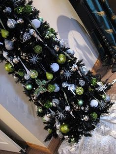 The White City Project: Black Christmas Tree with chartreuse green, white and silver decor... very near to what i'm planning for our own tree, this year!