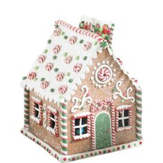 """This whimsical  gingerbread house can be displayed on the mantelpiece, as part of a tablescape, in the kitchen on a cake pedestal or adapt as a tree topper.  10"""" H ..."""