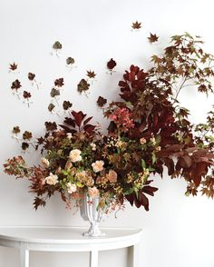 Smoke bush and peach garden and 'metallina' roses punctuate the greenery, which includes nandina foliage and Japanese maple leaves. Fall Wedding Flowers, Wedding Flower Arrangements, Fall Flowers, Floral Wedding, Floral Arrangements, Colorful Flowers, Flower Centerpieces, Autumn Wedding, Wedding Centerpieces