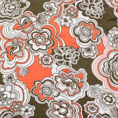 """Coral Coconut Euro Floral Cotton Spandex Blend Knit Fabric - Euro floral design in colors of coconut brown and coral on a white super soft cotton jersey rayon spandex blend knit.  Fabric is mid weight with a drapey hand and great 4 way stretch.  Big flowers measures 4 1/2"""".  ::  $6.50"""