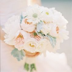 This style is called hand tied. I+ is always tight and round . I prefer using a bouquet holder So I can make the bouquet looser and more flowing. But Ive done plenty of this style. Style is up to you!!!