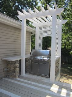 The ultimate outdoor grilling station!  I love this built in table area with rock pillars!An overhead light would make it perfect!