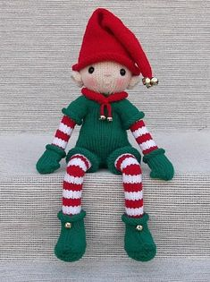 """This Christmas Elf, with his darling face, is knit in-the-round, and the arms, legs, body and head are all one piece. Sitting approx. 10"""" tall, Christmas Elf is worked in worsted wt. (Aran/10-ply) yarn, using approx. 270 total yds...Green (100 yds.), Red (100 yds.), White (30 yds.), Skin Color (40 yds.) He's a wonderful Christmas decoration, ready to sit on a ledge or shelf and enjoy the holiday season."""