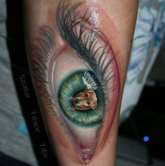This person must have truly loved their dog. Tattoo by Szalai 'Tibi' Tibor. #Inked #Inkedmag #tattoo #dog #love #eye #realism #animal