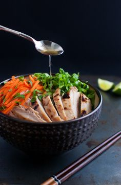 Vietnamese grilled chicken served with rice vermicelli noodles, fresh vegetables and herbs, and traditional Vietnamese dipping sauce from tamingofthespoon.com