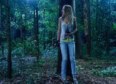 Angie (Britt Robertson) in the woods with the rest of the group trying to escape from Junior