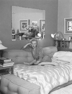 Photograph of Marilyn reading the Heinrich Heine book of poetry.