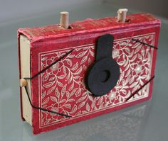 Shut up! But two of my big loves together!!!  Handmade pinhole cameras from old books