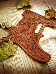 tooled leather pickguard. not my style, but wow. beautiful.