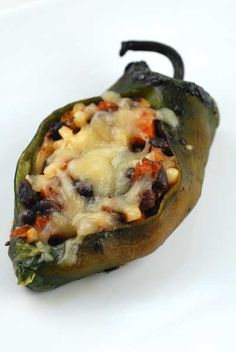 Stuffed Grilled Chili Relleno's - this dish is healthier for a number of reasons; no gluten, lots of veggies, much lower fat and you do not risk third degree burns when dropping chilies into hot oil.