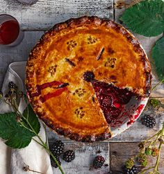The classic blackberry pie recipe is given an update by adding sloe gin before baking in a sweet pastry case.
