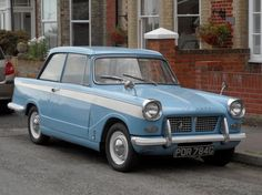 Triumph Herald. Ours was grey and cream.