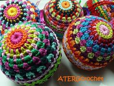 Colorful Christmas ball crochet pattern by ATERGcrochet - These are beautiful. You can also use old, ugly yarn to make cat toys- fill them with a plastic bag from the grocery store. They love the crinkle! I make them big enough that they cannot roll under the ridge.