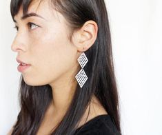 Double white diamond earrings, hand punched, made from reclaimed leather. FEATURES * * * • The mesh is formed by individually punching each hole by hand • Hooks are surgical stainless steel, which is fine for most sensitive ears. • Super light! We include earring stoppers on the back, so