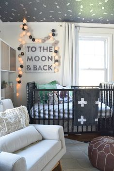 Our Baby Boys Nursery Reveal. Wallpaper on the ceiling, black Jenny Lind crib some of my favorite pieces- Nesting With Grace