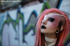 Cyber style makeup with pink hair, black lips