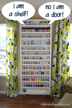 """Looking for craft room inspiration and organization ideas? This DIY paint storage shelf doubles as a hidden """"door"""" for a drop down ironing board."""