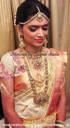Bridal look at it's best. Our bride Leelashree looks picturesque for her muhurtam. Makeup and hairstyle by Swank Studio. Pink lips. Maang tikka. Armlet. Bridal jewelry. Bridal hair. Silk sari. Jhumkis. Bridal Saree Blouse Design. Indian Bridal Makeup. Indian Bride. Gold Jewellery. Statement Blouse. Tamil bride. Telugu bride. Kannada bride. Hindu bride. Malayalee bride. Find us at https://www.facebook.com/SwankStudioBangalore