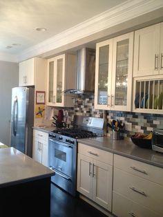 white kitchen with dark floors