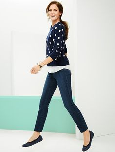 A classic white and pink polka-dot sweater gets a fun, new twist with an attached woven shirttail hem. An on-trend must-have.