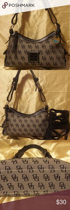 Dooney & Bourke Signature Bag, black/grey Cute Dooney monogram bag, blk leather and silver details. GUC. Slight wearing on one corner, priced accordingly Dooney & Bourke Bags Shoulder Bags