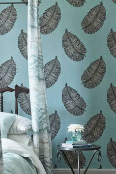 Paraggi by Osborne & Little is a large scale leaf motif wallpaper design with intricate details set against a tactile textured background.
