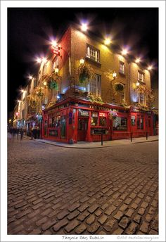 Temple Bar' in Dublin, Ireland. My Mum drew a picture of this when I was younger + I loved it so I have to see it in person.
