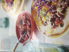 Southwestern Tortilla Pizzas Layer Black beans, cut-from-the-cob corn, and Cheddar cheese to create these oven roasted open faced tacos. Top with red cabbage and cilantro for color and crunch. (source: Good Housekeeping Magazine 6-12)