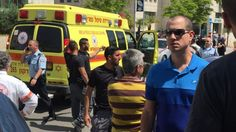 The Stabbing made by female attacker overpowered and arrested by security guard with no shots fired; second knife found in her bag; police investigating m..