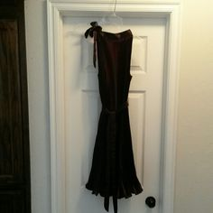 """Short purple party dress Eggplant colored knee lenght (5'9"""" tall) dress.  Ties at neck.  Belt is not attached and can be worn anywhere on the dress or not at all.  Satin material, no liner but the material is on the thick side for full coverage.  No size but I'm a size 6 and it fit perfect. Dresses"""