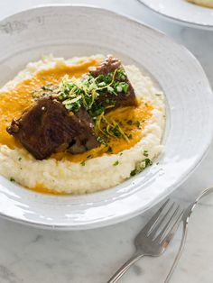 A perfect fall recipe for White Wine Braised Short Ribs with a parsnip and rutabaga puree topped with a simple gremolata.