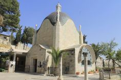 """Dominus Flevit is a Roman Catholic church on the Mount of Olives, opposite the walls of the Old City of Jerusalem. Dominus Flevit, which translates from Latin as """"The Lord Wept"""", was fashioned in the shape of a teardrop to symbolize the tears of Christ. Here, according to (Luke 19:37-42) Jesus, while walking toward the city of Jerusalem, becomes overwhelmed by the beauty of the 2nd Temple & predicting its future destruction,& the diaspora of the Jewish people,weeps openly aka Flevit super…"""