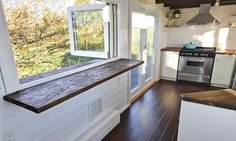This is a tiny house on wheels built by Tiny Living Homes with a big kitchen and a double sink vanity in the bathroom which makes it a great home to share. Tiny House Company, Tiny House Plans, Tiny House On Wheels, Tiny House Movement, Tiny House Living, Small Living, Bus Living, Living Area, Tiny House Nation