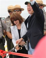 As part of the Tamiami Trail One-Mile Bridge Opening Ceremony on March 19, 2013, Assistant Secretary of the Army for Civil Works Jo-Ellen Darcy and Secretary of the Interior Ken Salazar cut a ribbon on the bridge deck prior to taking the inaugural drive across the fully-constructed bridge, which will be opened up to traffic in the upcoming weeks.