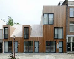 This small housing development in Amsterdam by Dutch studio Architecten features five homes, with untreated timber cladding and angular dormer windows. Architecture Amsterdam, Houses Architecture, Residential Architecture, Contemporary Architecture, Interior Architecture, Installation Architecture, Interior Design, Wooden Facade, Wooden Houses