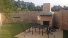 Custom Outdoor Fireplace  Great Iron Detail in the curve of this privacy wall custom painted to match existing house  www.southernhardscapesal.com