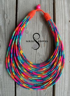 Items similar to Neon Bright yarn-wrapped necklace / tribal / hippie / bohemian / colorful / soft / neon / fluo on Etsy Fabric Beads, Felt Fabric, Fabric Jewelry, Tribal Necklace, Crochet Necklace, Hippie Bohemian, Neon Colors, Hippy, Beaded Earrings