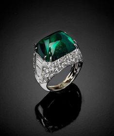 A Sugarloaf Cabachon Emerald and Diamond Ring by Montecarlo