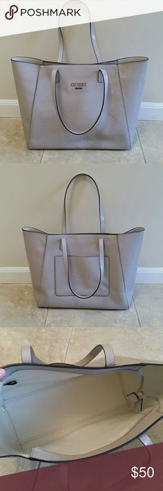 """Large Guess tote Guess tote EUC. 11.5"""" tall, 17"""" width on top, 14"""" on bottom. Beautiful bag! There is a light ink mark on bottom left of back, you can see in photo. Guess Bags Totes"""