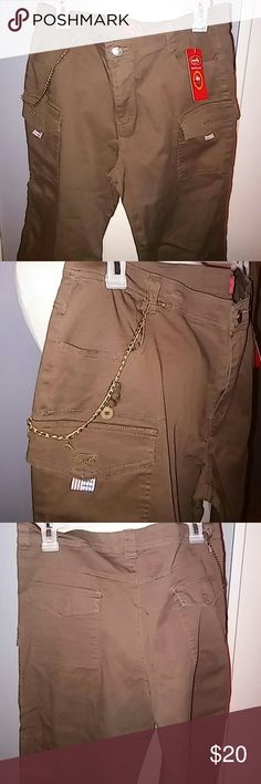 Capri for woman NWT. New with tag. Capri for woman. Has some ties to either wear them loose or tight from your legs. Four front  pockets . and two in the back. Its a size 14. In ladies size. Dark Brown Color. milly usa Shorts