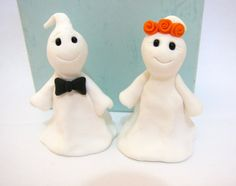 Halloween wedding cake topper, ghost bride and groom for $80.00.