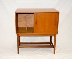 Mid-Century Danish Teak Record Cabinet | From a unique collection of antique and modern cabinets at https://www.1stdibs.com/furniture/storage-case-pieces/cabinets/