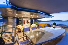 """The onyx and stainless steel dining table on the upper afterdeck of superyacht """"Nameless"""" Mondomarine allows for alfresco dining with incredible views. Expensive Yachts, Stainless Steel Dining Table, Power Boats For Sale, Dining Table Design, Super Yachts, Al Fresco Dining, Luxury Yachts, Models, Modern Architecture"""