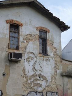 Street art in Lisbon by Vhils (Alexandre Farto)