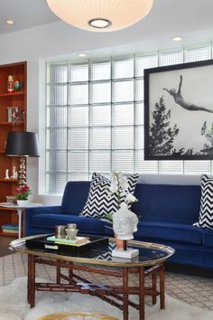 Is that electric blue or what! Love it with the black and white print hanging above it. Great put together room. LJH