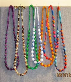 Great idea for my little neck scarfs (that I never wear)...can also eliminate the beads and just tie a knot in between the marbles.