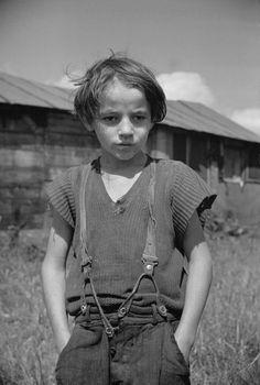 wood cutter's son Eden Mills, Vermont (Photo by Carl Mydans, FSA 1936).