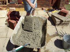 mixing vermiculite and cement to make the insulating layer to go on top of the concrete slab. this helps keep the heat inside the oven
